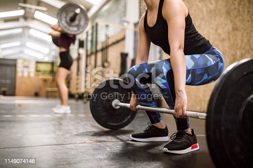 Woman Athlete Weightlifting Warm Up Exercises On Cross Training
