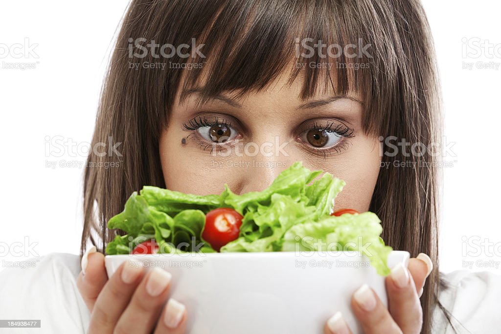 Young woman preparing healhty salad stock photo