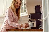 istock Young woman preparing morning coffee 1197289973