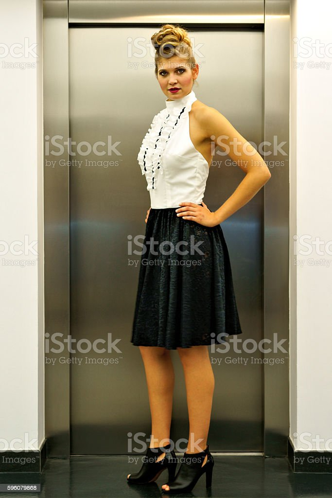 Young woman presents clothing royalty-free stock photo