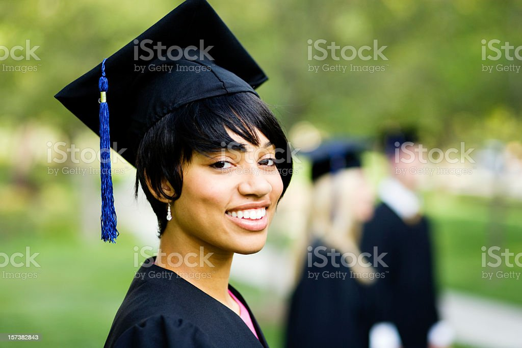 Young Woman Profile in Graduation Gown stock photo