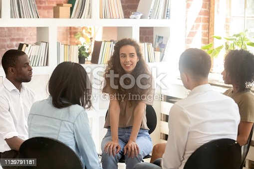 istock Young woman psychologist sitting in circle among diverse people talking 1139791181