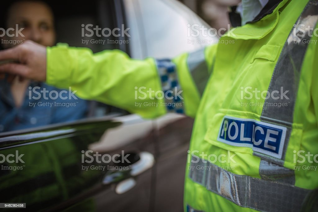 Young woman pulled over by police stock photo