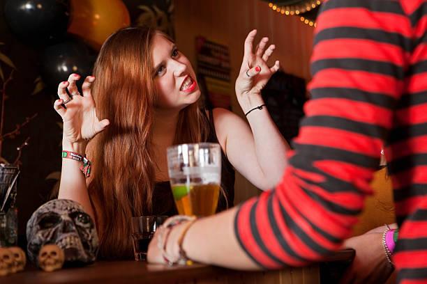 """junge frau ziehen am freunden in der bar """"faces"""" - bier kostüm stock-fotos und bilder"""