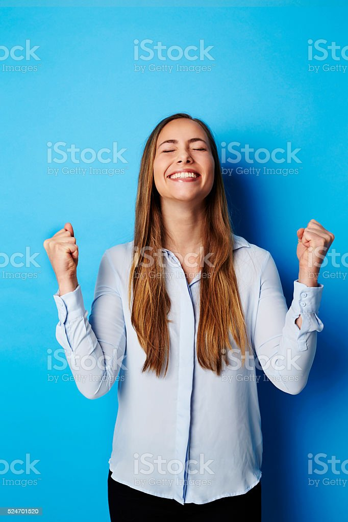 Young woman punching air in happiness stock photo