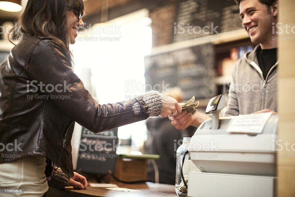 Young woman purchasing coffee stock photo