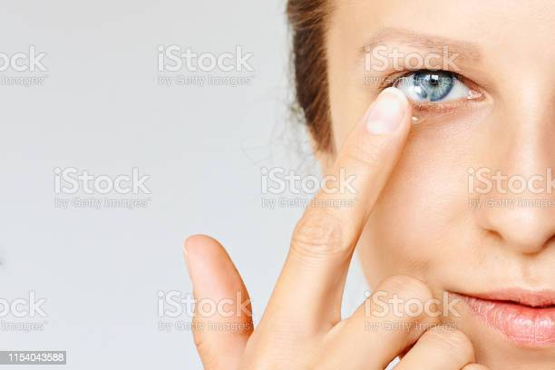 Young woman puts contact lens in her eye picture id1154043588?b=1&k=6&m=1154043588&s=612x612&h=3qkynbubd0noliozn3lbc3xxlq v1r4ujivtip1no7s=
