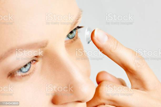 Young woman puts contact lens in her eye picture id1154043853?b=1&k=6&m=1154043853&s=612x612&h=5rjauee9uq9tmwdghiciavbctg0likw9uejxx4rjlss=
