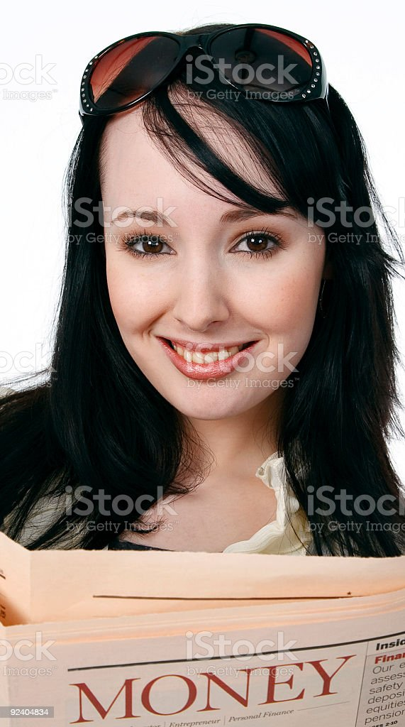 Young woman reading a financial newspaper royalty-free stock photo