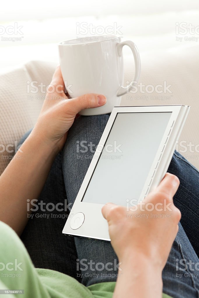 Young Woman Reading an eBook royalty-free stock photo