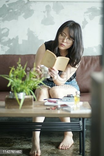 Young woman reading at home,Japan