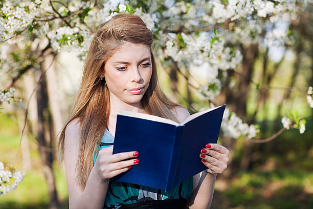 young woman reading book - violetastoimenova stock photos and pictures