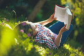 Young woman reading in the garden