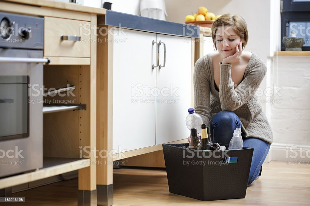 Young Woman Reading Labels on Recycleable Bottle stock photo