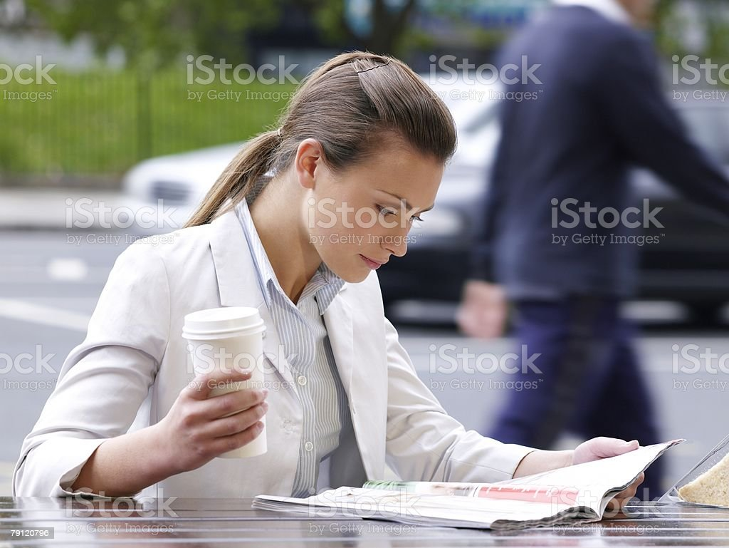 Young woman reading magazine royalty-free stock photo
