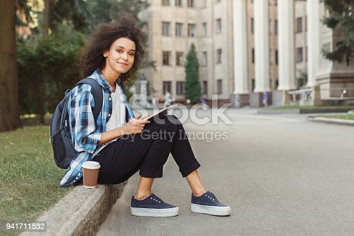 istock Young woman reading notes at university copy space 941711532