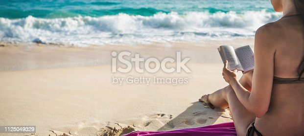 Young Woman Reading on Tropical White Beach. Summer Vacation Traveling Relaxation
