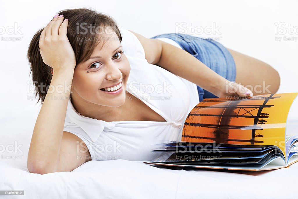 Young woman reading travel magazine royalty-free stock photo