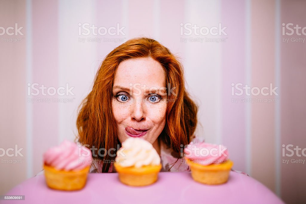 Young Woman Really Wants To Eat Cupcakes stock photo