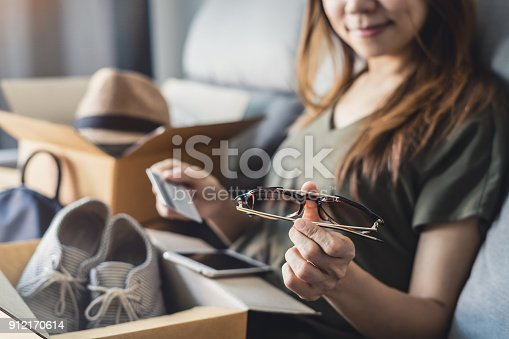istock young woman received online shopping parcel opening boxes 912170614