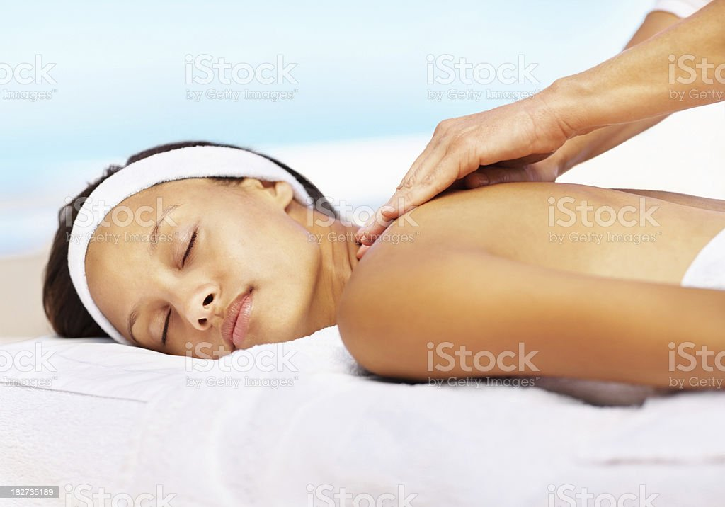 Young woman receiving a back massage at spa royalty-free stock photo