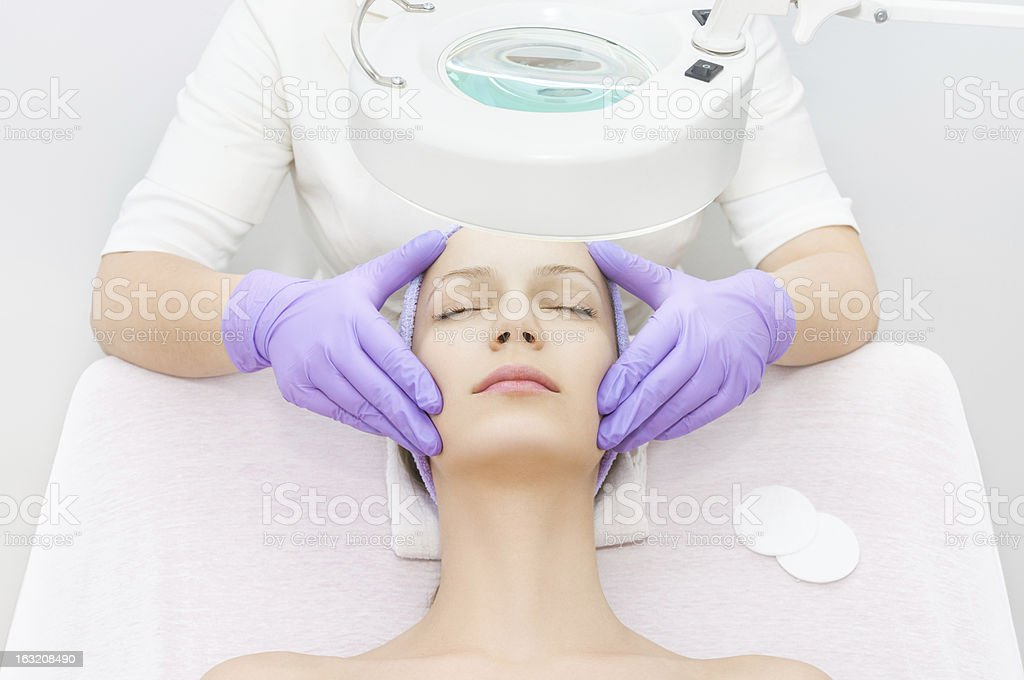 Young woman receiving beauty therapy stock photo