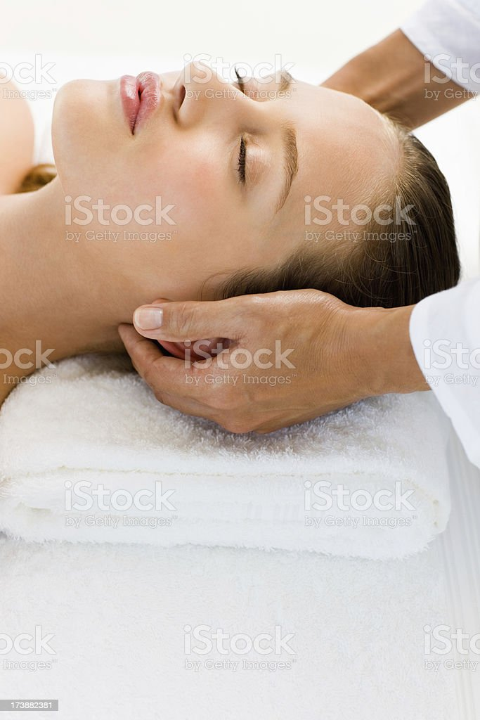 Young woman receiving beauty treatment at spa royalty-free stock photo