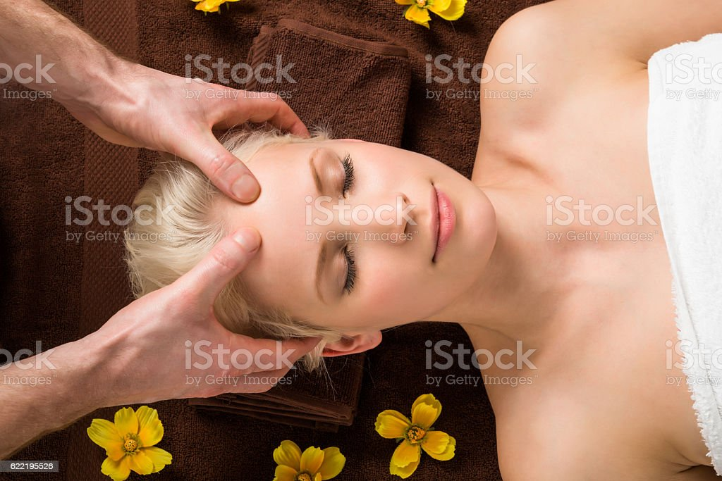 Young Woman Receiving Head Massage At Spa stock photo