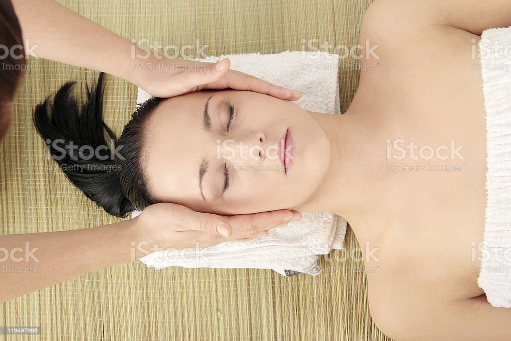 Young woman receiving head massage royalty-free stock photo