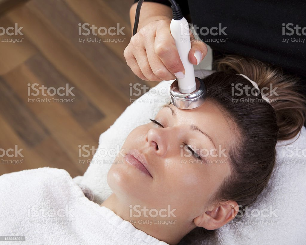 Young woman receiving laser therapy royalty-free stock photo