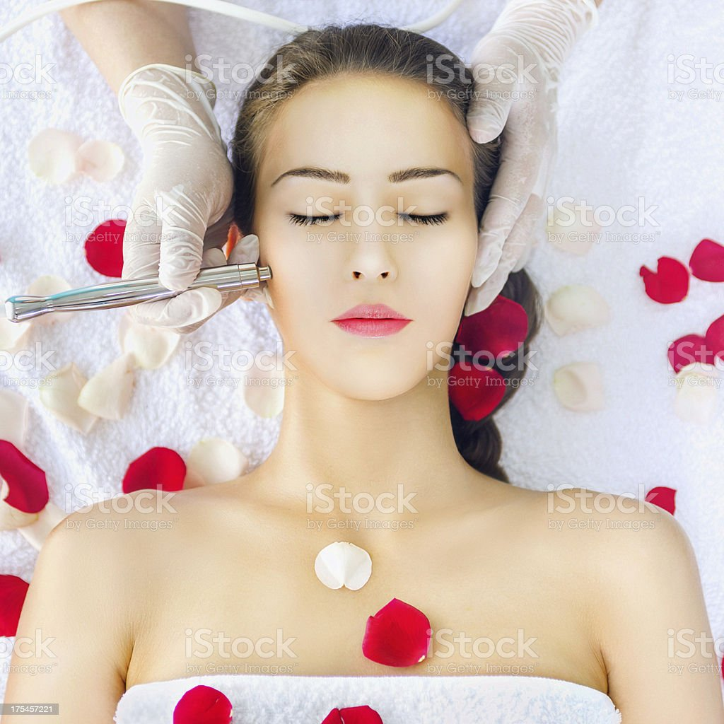 A young woman receiving microdermabrasion treatment stock photo