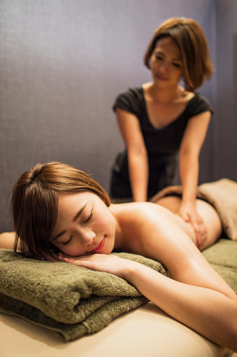 Young Woman Receiving Oil Massage Stock Photo - Download