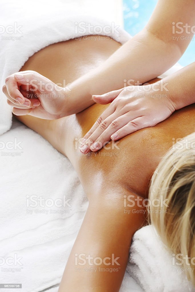Young woman receiving professional massage stock photo