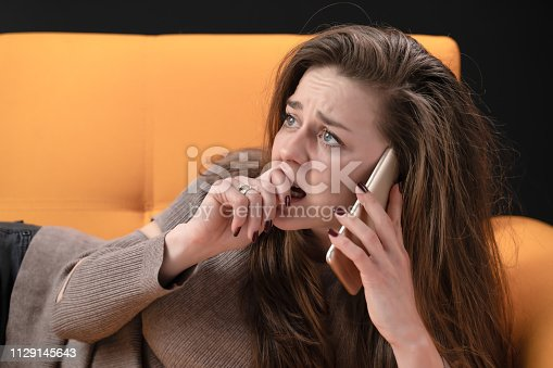 istock Young woman receiving scary news over the phone 1129145643