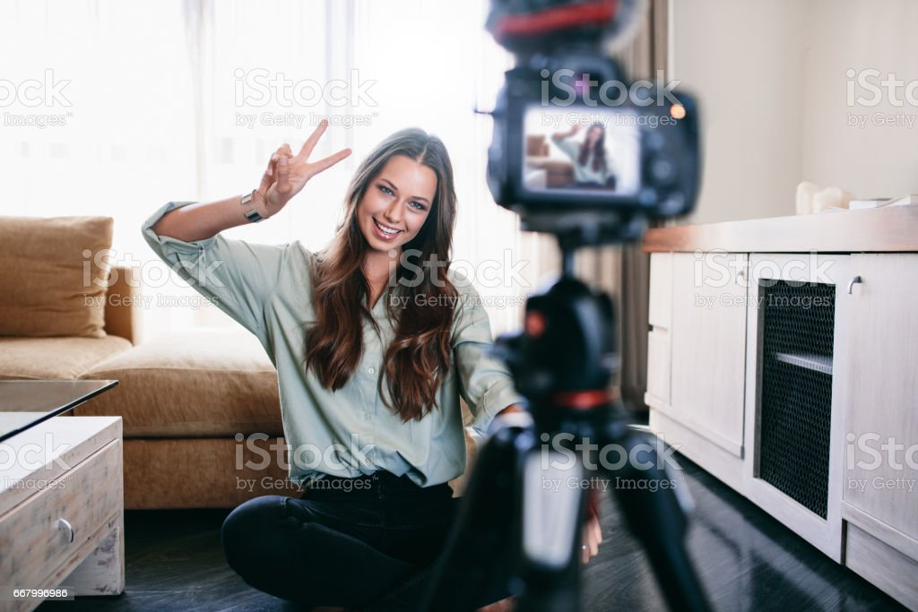 Young woman recording content for her blog. stock photo
