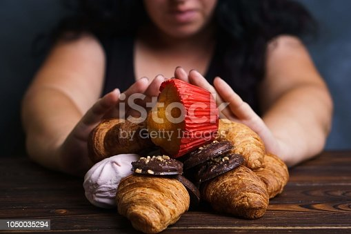 istock Young woman refuse eating junk food 1050035294