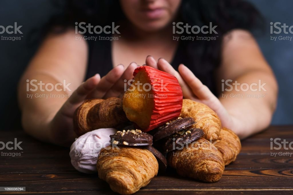 Young woman refuse eating junk food stock photo