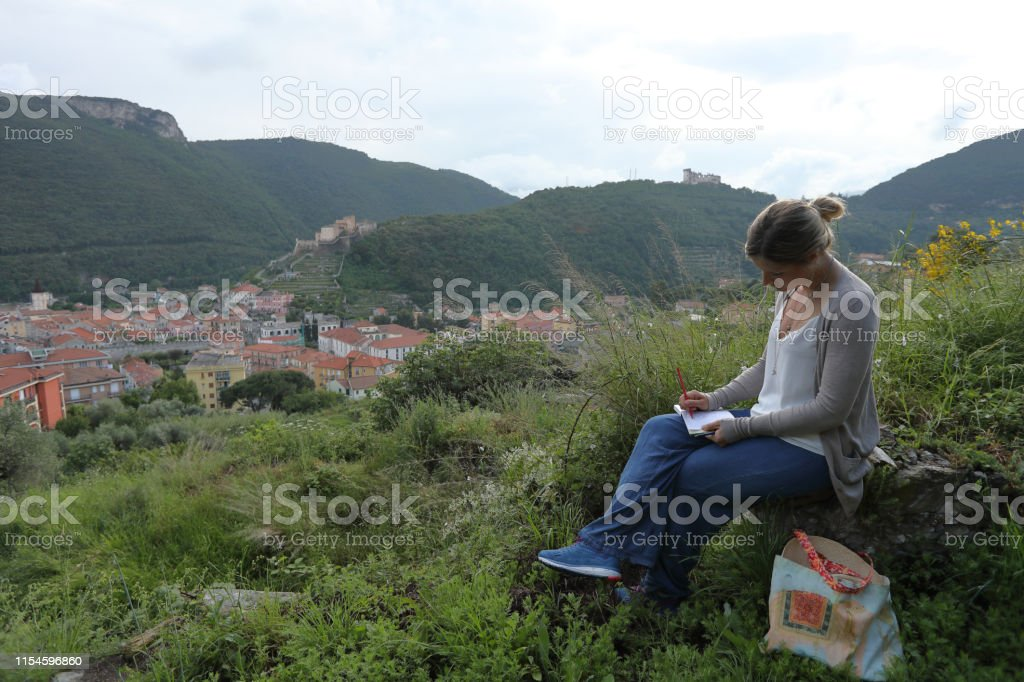 She sketches village and distant castles