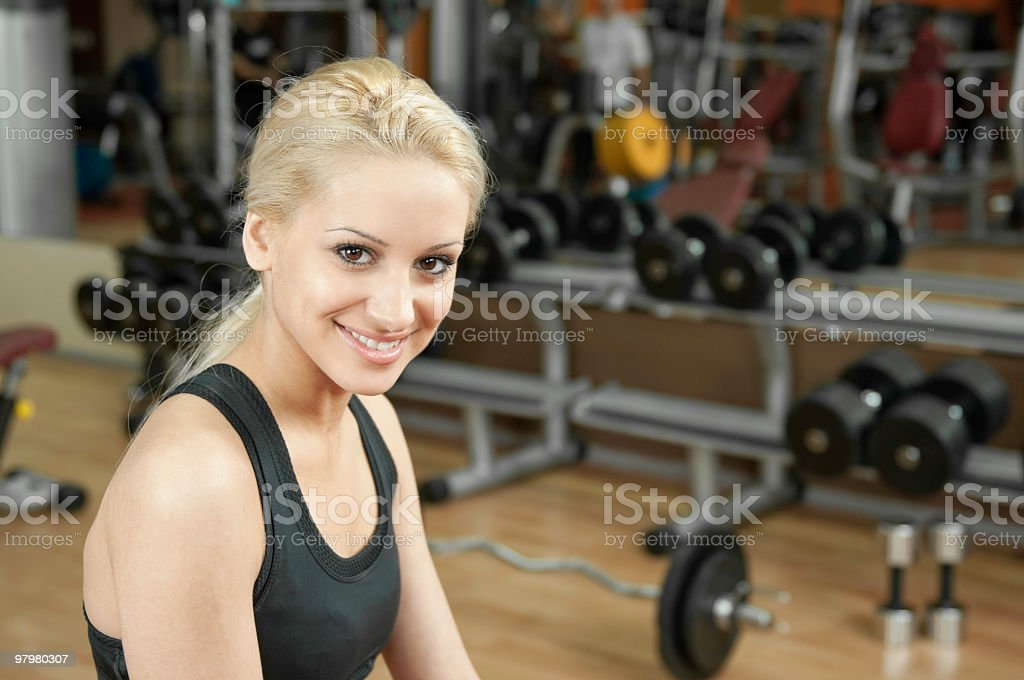 Young woman relaxes between the fitness exercises royalty-free stock photo