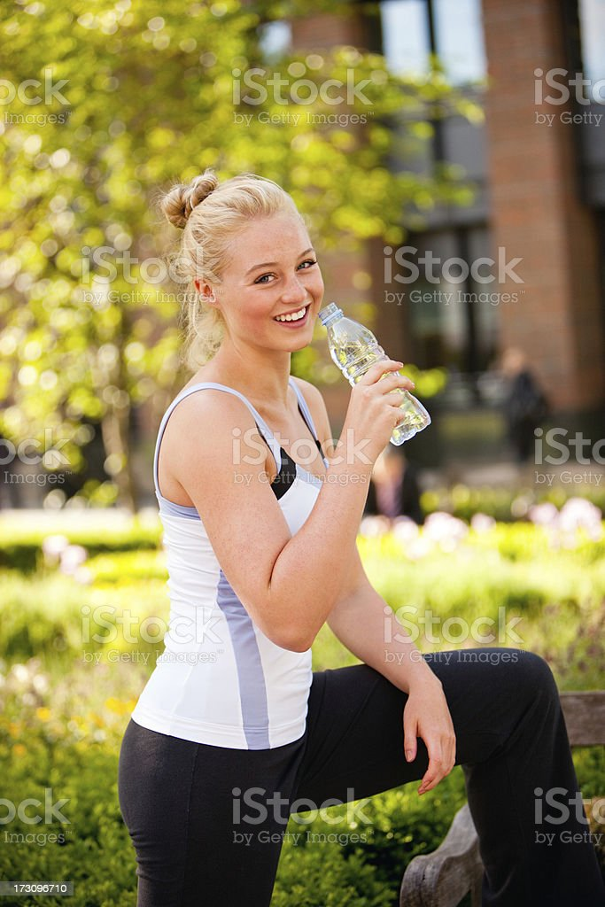 Young Woman relaxing after exercising in city park, London royalty-free stock photo