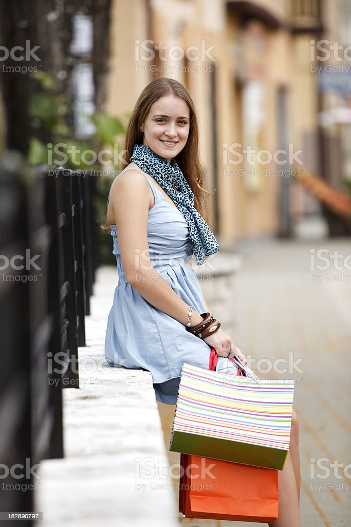 Young woman relaxing after shopping royalty-free stock photo