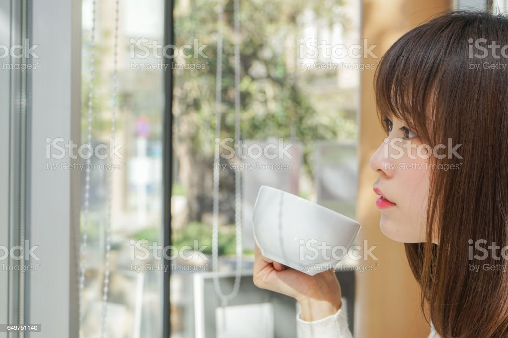 Young woman relaxing at cafe stock photo
