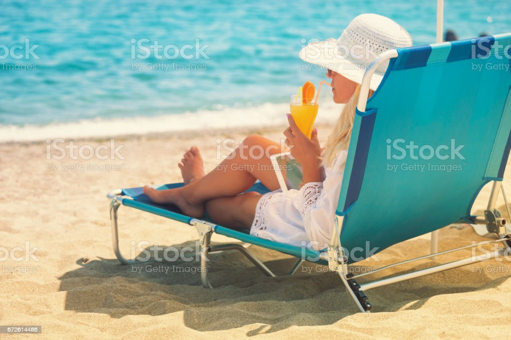 Young Woman Relaxing At The Beach stock photo