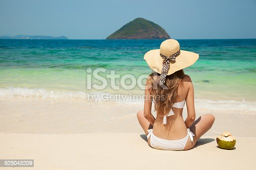 istock Young Woman Relaxing At Tropical Beach 525043209