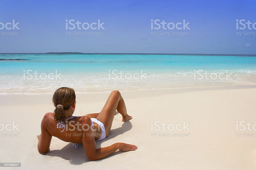 young woman relaxing beach royalty-free stock photo
