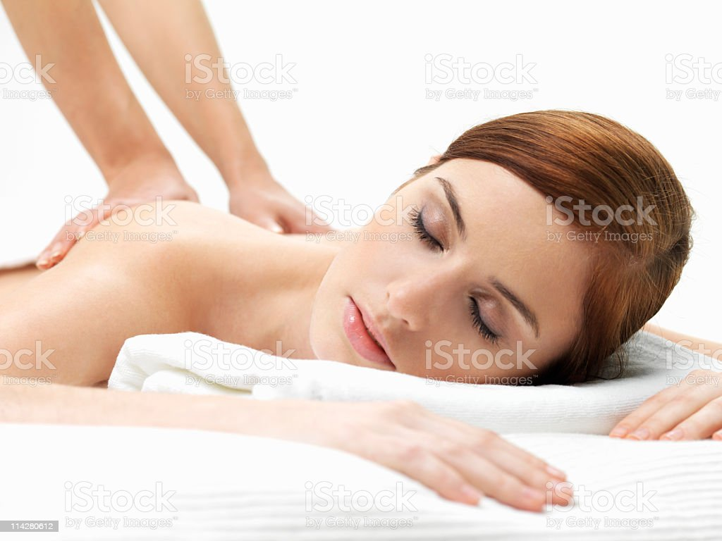 young woman relaxing during a body massage royalty-free stock photo