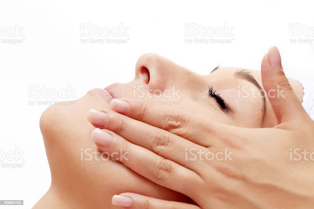 Young woman relaxing having a facial treatment royalty-free stock photo