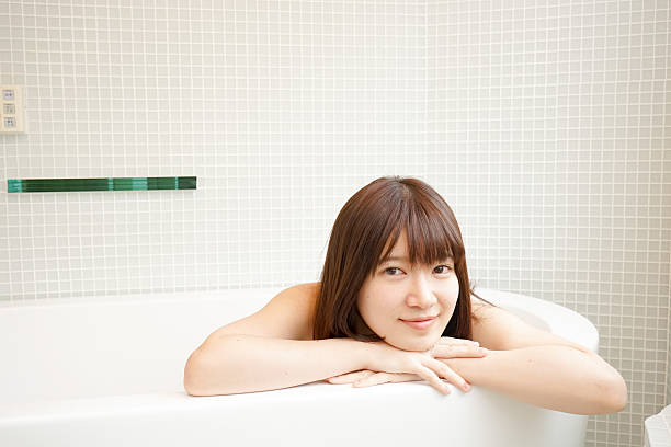 young woman relaxing in a bathroom - japanese bath woman bildbanksfoton och bilder
