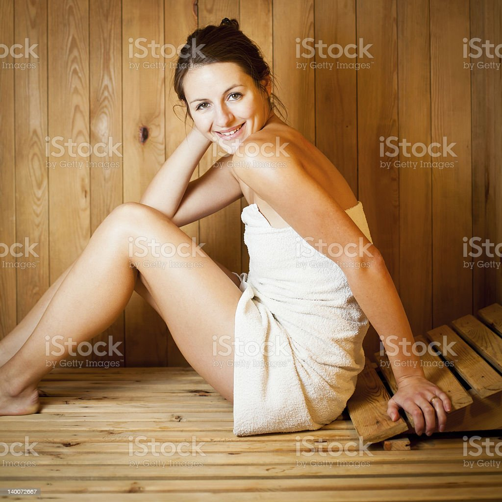 Young woman relaxing in a sauna royalty-free stock photo