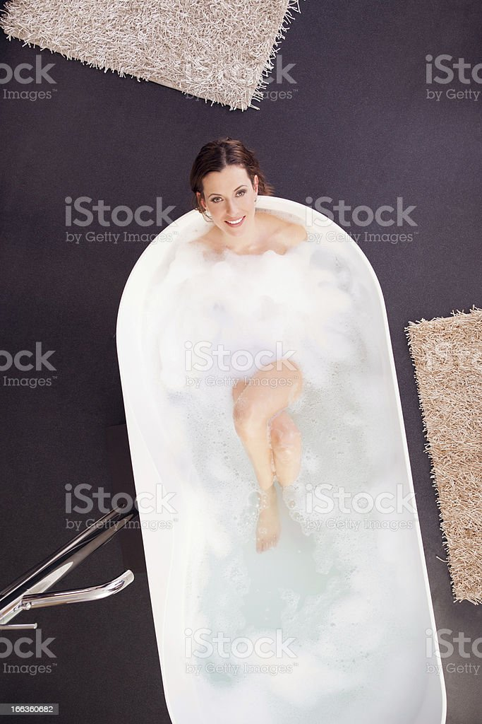 Young woman relaxing in bath royalty-free stock photo